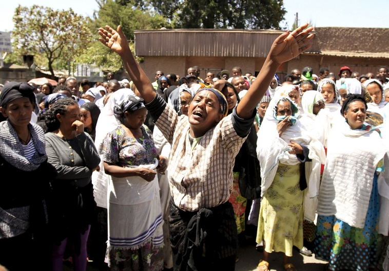 A woman cries at a gathering for the 30 Ethiopian victims killed by members of the militant Islamic State in Libya, in the capital Addis Ababa