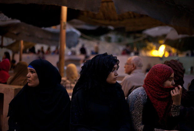 On October 31, 2013, Muslim women wait in front of St. Sama'ans Church for the exorcism to start.